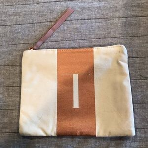 "NWOT fabric cosmetic bag with letter ""T"""